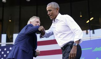 Former President Barack Obama, right, gives an elbow bump to Democratic gubernatorial candidate, former Virginia Gov. Terry McAuliffe during a rally in Richmond, Va., Saturday, Oct. 23, 2021. McAuliffe will face Republican Glenn Youngkin in the November election. (AP Photo/Steve Helber)