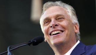 Democratic gubernatorial candidate, former Virginia Gov. Terry McAuliffe smiles during a rally in Richmond, Va., Saturday, Oct. 23, 2021. McAuliffe will face Republican Glenn Youngkin in the November election. (AP Photo/Steve Helber)