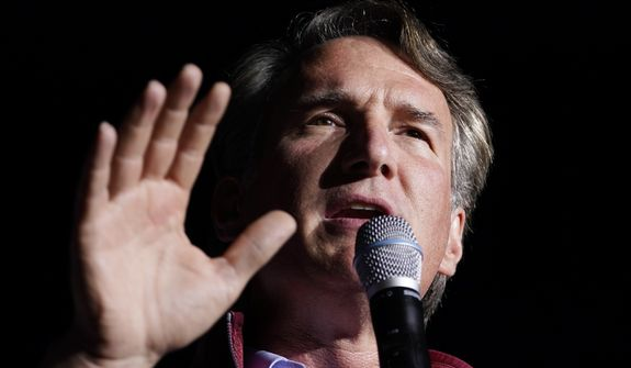 Republican gubernatorial candidate Glenn Youngkin gestures during a rally in Glen Allen, Va., Saturday, Oct. 23, 2021. Youngkin will face Democrat Terry McAuliffe in the November election. (AP Photo/Steve Helber)