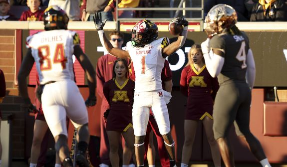 Maryland wide receiver Marcus Fleming (1) holds the ball in the end zone after scoring a touchdown against Minnesota during the second half of an NCAA college football game Saturday, Oct. 23, 2021, in Minneapolis. (AP Photo/Stacy Bengs)