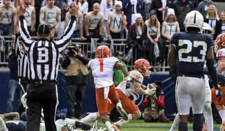 Illinois wide receiver Casey Washington (14) after catching a pass for a 2-point conversion in the ninth overtime to defeat Penn State 20-18 in an NCAA college football game in State College, Pa.on Saturday, Oct. 23, 2021. (AP Photo/Barry Reeger)