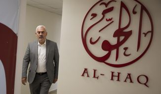 Shawan Jabarin, director of the al-Haq human rights group, at the organization's offices in the West Bank city of Ramallah, Saturday, Oct. 23, 2021. Israel on Friday, Oct. 22, declared six prominent Palestinian human rights groups to be terrorist organizations, saying they were secretly linked to a left-wing militant movement. It was not immediately clear what the distinction would mean for the groups, most of which also protest rights violations by the Western-backed Palestinian Authority. (AP Photo/Majdi Mohammed)