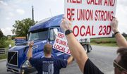 FILE - In this Sept. 13, 2021 file photo, members of Local 23D Union picket in front of Heaven Hill Distillery in Bardstown, Ky.  Workers at one of the world's largest bourbon producers, are scheduled to vote on a new contract on Saturday, Oct. 23, six weeks after walking out. The company announced a tentative contract agreement with the union representing striking workers on Friday(Silas Walker/Lexington Herald-Leader via AP, File)