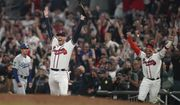 Atlanta Braves relief pitcher Will Smith celebrates after winning Game 6 of baseball's National League Championship Series against the Los Angeles Dodgers Sunday, Oct. 24, 2021, in Atlanta. The Braves defeated the Dodgers 4-2 to win the series. (AP Photo/Brynn Anderson)