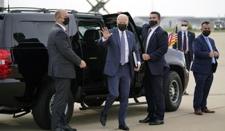 """President Joe Biden arrives to board Air Force One at Delaware Air National Guard Base for a trip to New Jersey to promote his """"Build Back Better"""" agenda, Monday, Oct. 25, 2021, in New Castle, Del. (AP Photo/Evan Vucci)"""