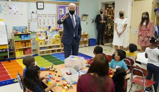 """President Joe Biden talks to students during a visit to East End Elementary School to promote his """"Build Back Better"""" agenda, Monday, Oct. 25, 2021, in North Plainfield, N.J. (AP Photo/Evan Vucci)"""