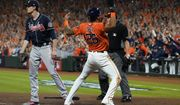 Houston Astros' Jose Siri celebrates past Atlanta Braves starting pitcher Max Fried on a throwing error during the second inning in Game 2 of baseball's World Series between the Houston Astros and the Atlanta Braves Wednesday, Oct. 27, 2021, in Houston. (AP Photo/Eric Gay)
