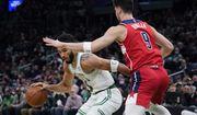 Boston Celtics forward Jayson Tatum (0) tries to drive past Washington Wizards forward Deni Avdija (9) during the first half of an NBA basketball game, Wednesday, Oct. 27, 2021, in Boston. (AP Photo/Charles Krupa)
