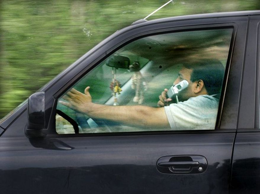 This driver in Lawrenceville, N.J., likely gummed up the ride for his fellow motorists, according a new study that looked at how using cellphones can impair speed and traffic awareness. (Associated Press)