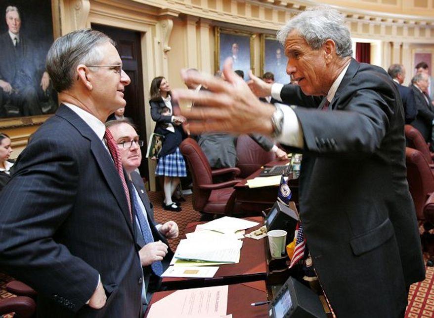** FILE PHOTO ** Senate Democratic Leader Richard L. Saslaw (right), Fairfax Democrat, talks with Sen. Thomas K. Norment Jr., James City Republican. (Associated Press)