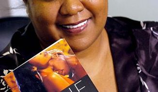 "** FILE **Zane, a famous author of steamy sex novels set among the black professional class, holds ""Afterburn,"" one of her two New York Times bestsellers, in this April 25, 2007 file photo at the Upper Marlboro, Md. offices of Strebor Books, a Simon & Schuster imprint that she runs. The Karibu Books chain, based in the Washington, D.C., area and one of the few remaining retailers to specialize in black books, is closing after 15 years. ""I was shocked to hear the news,"" said Zane, the best-selling author who lives in suburban Maryland. Zane, known for such erotic novels as ""Afterburn"" and ""Addicted,"" said that Karibu had stocked her books when no one else would and had been the first store where she appeared for a signing. (AP Photo/ Steve Ruark,File)"