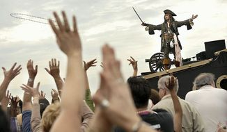 ** FILE ** In this 2008 photo, faux pirates cruised Tampa's waterfront for the city's Gasparilla festival, which drew about 300,000 people. (Rod Lamkey Jr./The Washington Times)