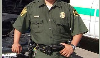 U.S. Border Patrol Agent Luis Aguilar Jr. was placing spike strips in the path of two vehicles thought to have entered the U.S. illegally from Mexico when one of them struck him. (AP Photo)