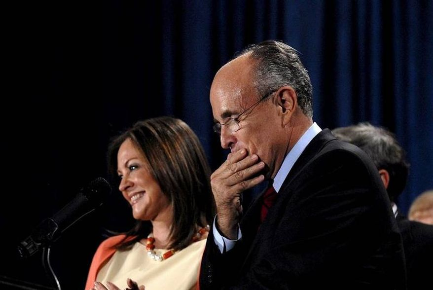 Republican presidential candidate and former New York City Mayor Rudy Giuliani, shown on stage by his wife, Judy, delivering a post-primary speech at Loews Portofino Bay Hotel at Orlando, Fla., placed third in the state's Republican contest tonight. Mr. Giuliani stopped short of announcing he was ending his run.