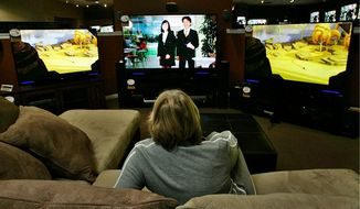 Mary Addison considered televisions and furniture Tuesday at a store in La Habra, Calif., contributing to the enormous increase of those seeking entertainment centers in the week leading up to Super Bowl Sunday.