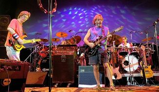 ** FILE ** The Grateful Dead perform during a reunion concert on Saturday, Aug. 3, 2002, in East Troy, Wis. From left are Phil Lesh, Bill Kreutzmann, Bob Weir and Mickey Hart. (AP Photo/Morry Gash)