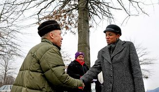 Donna Edwards, who ousted eight-term incumbent Rep. Albert R. Wynn in the 4th Congressional District, greeted supporter Theodore Lewis of Germantown outside Lake Seneca Elementary School Tuesday. (Katie Falkenberg/The Washington Times)