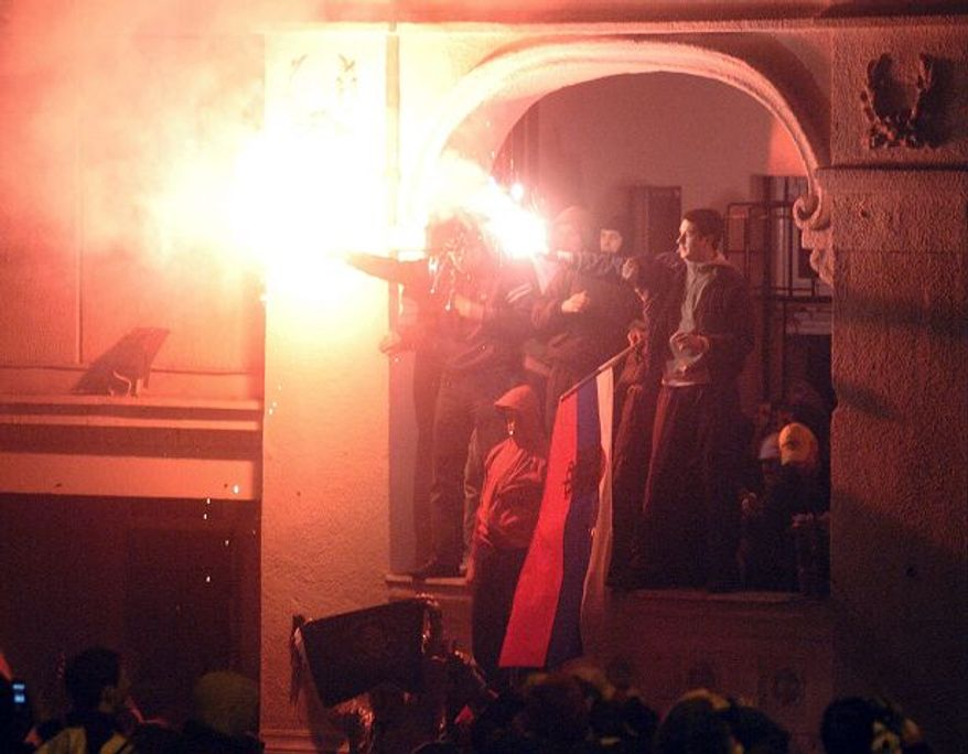 **FILE** Furious Serbian nationalists refusing to recognize Kosovo's sovereignty stormed the U.S. Embassy in Belgrade in 2008, throwing furniture, flares and Molotov cocktails inside a satellite building they were able to break into.