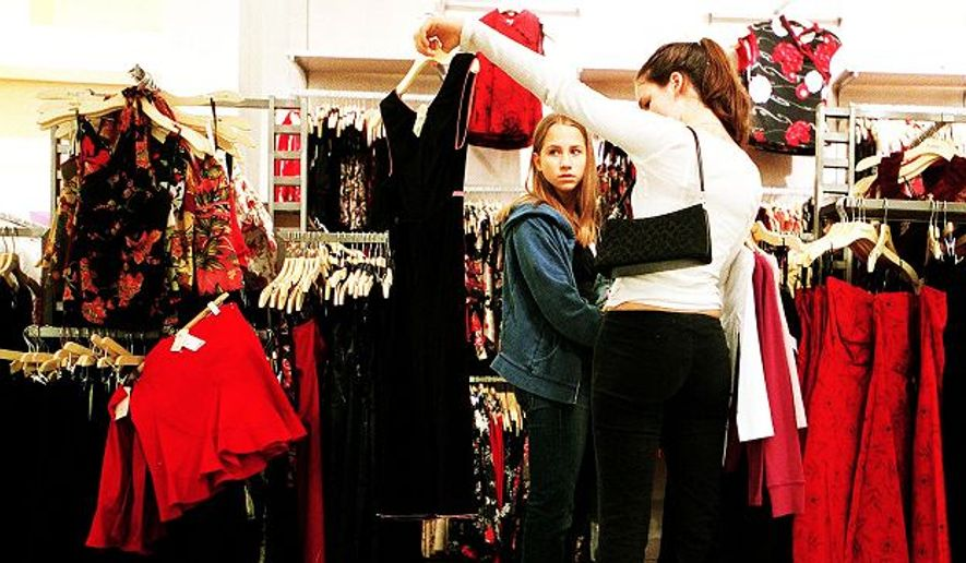Emily Boone (right), 15, consulted with her friend Becky Harmik at the Fair Oaks Mall, but so-called millennials also help their boomer parents shop. (Erin McCracken/The Washington Times) **FILE**