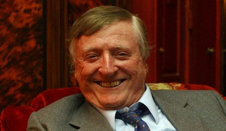 """William F. Buckley Jr., the conservative pioneer and television """"Firing Line"""" host, smiles during an interview at his home in New York on July 20, 2004. Buckley died in 2008."""