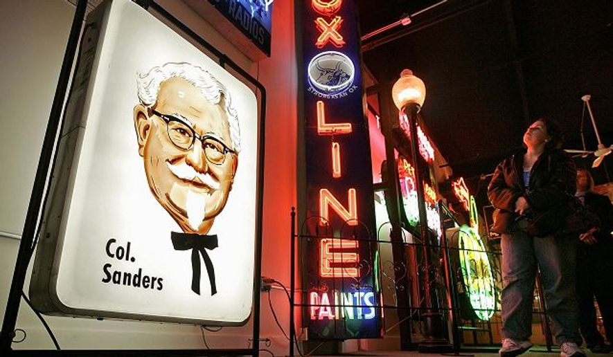 Signs from the late 1800s to the present can be seen at the American Sign Museum, and a Kentucky Fried Chicken sign from the 1950s is among them (above left). (Associated Press)
