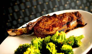 ** FILE ** The Greystone Grill's 20-ounce rib-eye steak is cowboy-cut but well-served with broccoli. (Michael Connor/The Washington Times)