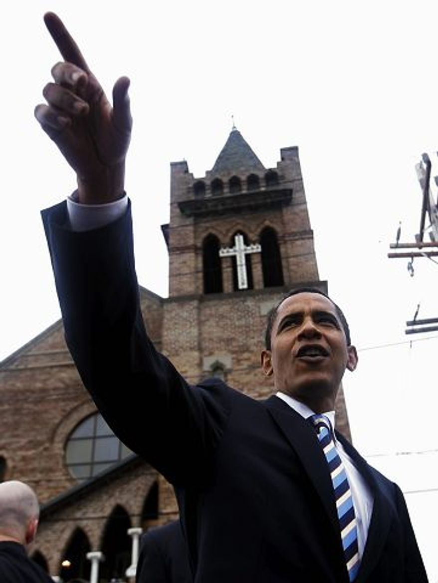 President Obama, shown in this 2008 photo, acknowledges the crowd as he leaves First Emanuel Baptist Church in New Orleans during his presidential campaign.