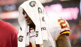 Photos by Michael Connor / The Washington Times Clinton Portis has rushed for just 494 yards after recording 1,487 last season while starting all 16 games.